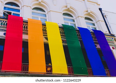 DUBLIN, IRELAND - June 27th, 2018: rainbow flags off a building in Dublin's main street Grafton Street for the Pride month in support of gay rights and equality