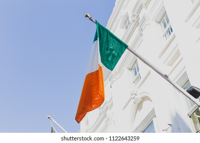 DUBLIN, IRELAND - June 27th, 2018: Irish flag waving off a building in Grafton Street, the main shopping district of the city