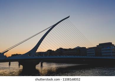 DUBLIN, IRELAND - June 3rd, 2018: the Samuel Beckett bridge on the river Liffey in Dublin at dusk