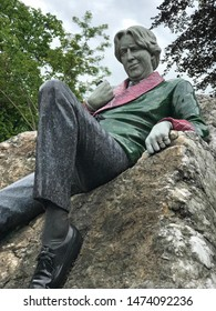 Dublin, Ireland - June 7, 2019: A sculpture of Oscar Wilde is shown atop a quartz boulder in Merrion Square. The statue was designed and created by Danny Osborne and was unveiled in 1997.