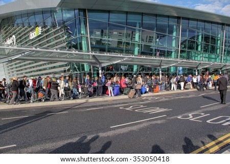DUBLIN, IRELAND - JUNE 9, 2012: Travellers queue outside airport building after stranded for a while due to a false alarm atDublin airport, Ireland