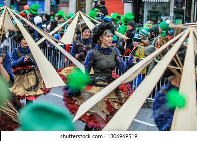 Dublin, Ireland - March 17, 2018: Young People dancing and Playing in the Traditional Costumes on the Parade