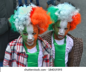 DUBLIN, IRELAND - MARCH 17: Two unidentified children with colorfully painted faces and hair attend the annual St. Patrick's Day Parade on March 17, 2014 in Dublin, Ireland.