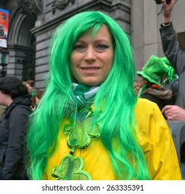 DUBLIN, IRELAND - MARCH 17: An unidentified, costumed female spectator wearing a green wig and large shamrock necklace during the St. Patrick's Day Parade on March 17, 2015 in Dublin, Ireland.