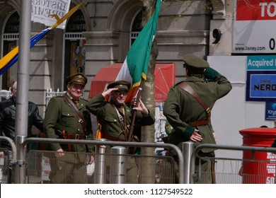 Dublin, Ireland - March 26th 2016: Men in vintage Irish Republican uniforms salute each other during Centenary / 100th Anniversary of the Easter rising on O'Connell Street, Dublin.
