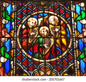 DUBLIN, IRELAND - MARCH 30, 2013: Colorful stained glass depicting religious scene in Dublin cathedral