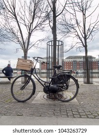 DUBLIN, IRELAND - MARCH 6th 2018: A bike with a wooden box at the front. This was taken in Hanover quay in Dublin.