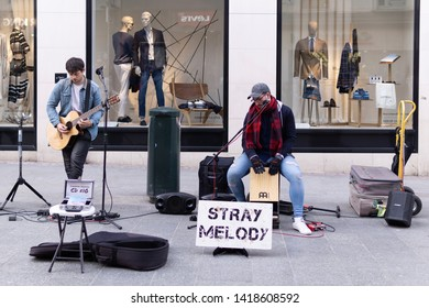 Dublin, Ireland - May 11 19 : Two local street artists are performing their original musics at the Grafton Street during summer