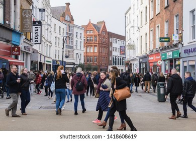 Dublin, Ireland - May 11 19 : Lots of locals and tourists are walking along The Grafton Street, the most famous street in Dublin. This street has a lots of premium outlets like LV, Victoria Street