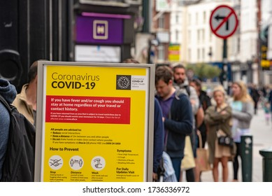 Dublin, Ireland - May 16 2020: Long line of people queueing outside of a supermarket on Grafton Street mantaining social distance during coronavirus COVID-19 lockdown