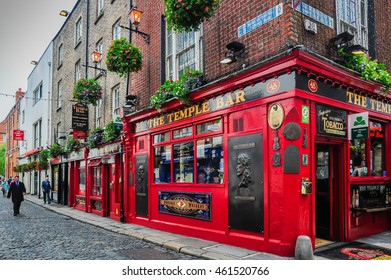 DUBLIN, IRELAND - MAY 20, 2014: A man walks down Dame Street near a popular bar in the Temple Bar district of Dublin, Ireland