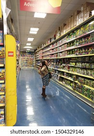 Dublin, Ireland - May 20, 2015: A women was looking for a toys in Smyths Toys Superstores.