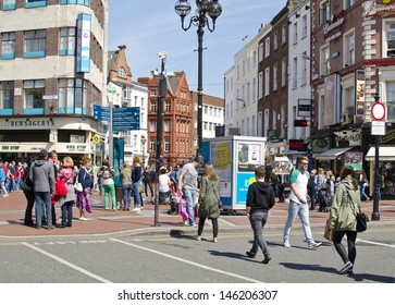 DUBLIN, IRELAND - MAY 25: the junction of Grafton Street and St. Stephen's Green on May 25, 2013 in Dublin, Ireland. Grafton Street is one of two main shopping streets in Dublin.