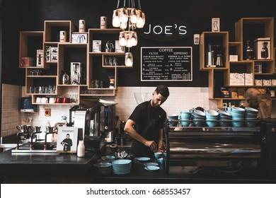 Dublin, Ireland May 26, 2016  Joe's coffee shop, barista making coffee