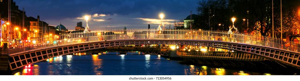 Dublin, Ireland. Night view of famous Ha Penny bridge in Dublin, Ireland