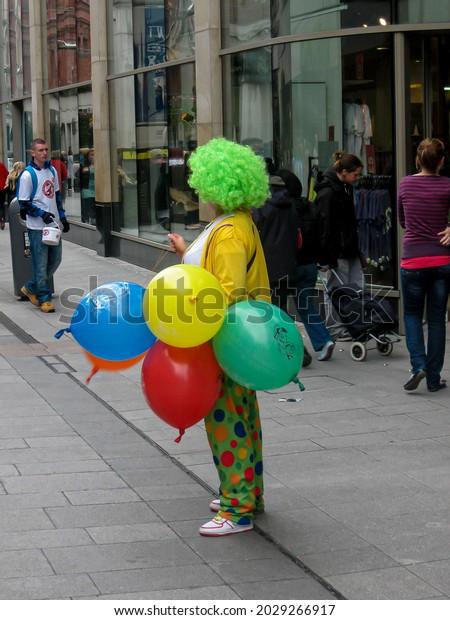 Dublin Ireland - November 10  2009: Clown with colourful balloons on the street of Dublin