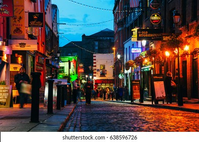 DUBLIN, IRELAND - NOVEMBER 11, 2014: Nightlife at popular part of the city Temple Bar quarter in Dublin, Ireland. The area is the location of many bars, pubs and restaurants