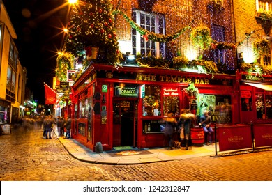 Dublin, Ireland - November 15, 2018: People around the famous red pub in the Temple Bar district in Dublin during the Christmas season