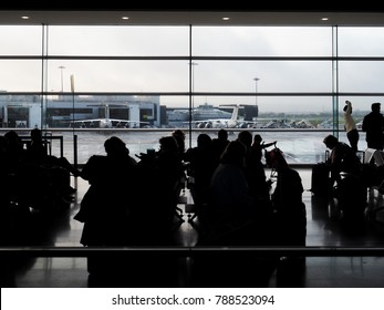 Dublin, Ireland - November 2017: Travelers silhouettes at Dublin Airport: this is an international airport serving Dublin, the capital city of Ireland.