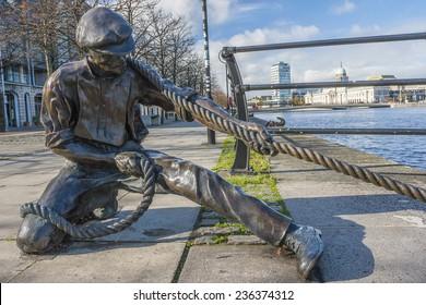 Dublin, Ireland - Oct 25, 2014: The Linesman statue at Liffey river in Dublin, Ireland on October 25, 2014