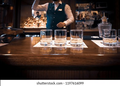 DUBLIN, IRELAND. OCTOBER 03, 2018. Barman serving whiskey to tourists at Pearse Lyons Distillery, located in an area known as The Liberties.