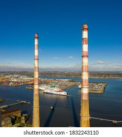 Dublin / Ireland - October 2020 : Aerial view of Poolbeg Generating Station colloquially known as The Poolbeg Stacks a power station operated by ESB. Stena line ferry visible at the far distance.