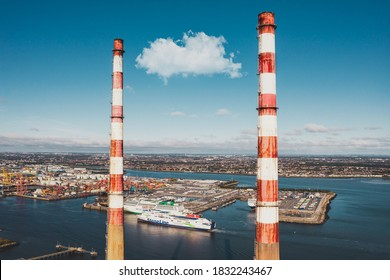 Dublin / Ireland - October 2020 : Aerial view of Poolbeg Generating Station known as The Poolbeg Stacks a power station operated by ESB. Stena line ferry visible at the far distance.