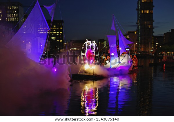 DUBLIN, IRELAND - OCTOBER 27, 2019: Night Watch, magical installation on the water. The Bram Stocker Festival in Dublin. Halloween celebration.