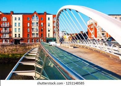 Dublin, Ireland. Samuel Becket Bridge at day in Dublin, Ireland. Beautiful architecture. Car traffic, clear blue sky