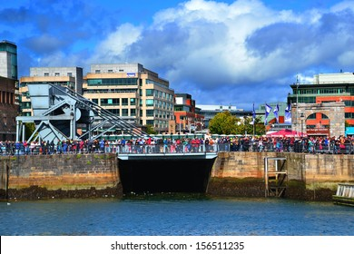 DUBLIN, IRELAND - SEPT 15: Unidentified spectators line the River Liffey at the Dublin Airfest on September 15, 2013 in Dublin, Ireland. The free air spectacular attracted 130,000 people.