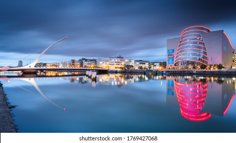 Dublin, Ireland - September 07 2018: The Samuel Beckett bridge and the Convention Center Dublin are reflecting in the Liffey river. This shot was taken during the blue hour.