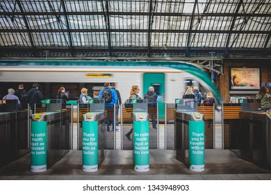 Dublin, Ireland - September, 23 2018: Crowd moving near modern turnstile and train on Pearse Station in rush hour