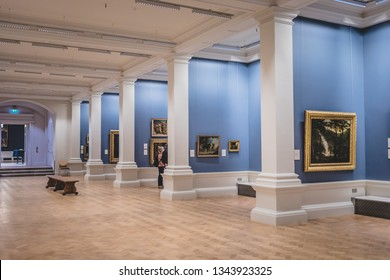 Dublin, Ireland - September, 24 2018: Majestic view of spacious showroom with blue walls decorated with various artworks in National Gallery