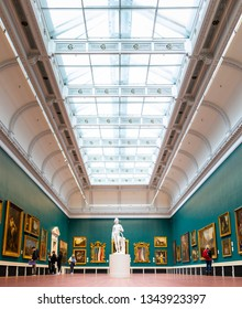 Dublin, Ireland - September, 24 2018: Wonderful view of spacious showroom with various classical artworks and large glass ceiling in National Gallery