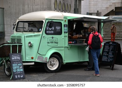 Dublin, Ireland-08-07-2015: Pastel green food car selling drinks and snacks, people are  in line at Trinity college courtyard