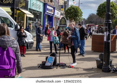 Dublin, Ireland,25th March 2019.  A young singer,Paul Jenkinson, busking near St. Stephens Green.