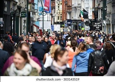 DUBLIN - JUL 22: Crowds of people walk on Grafton Street on Jul 22, 2015 in Dublin, Ireland. The street is a main tourist attraction in the Irish capital, renowned for its lively atmosphere and shops.