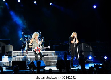 DUBLIN - JUNE 12 : Joe Elliot (R) and Rick Savage (L) of Def Leppard rock group on stage during their 2009 tour at The O2 Dublin June 12, 2009 in Dublin.