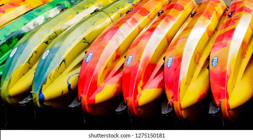 dublin, leinster/ireland - 11/13/2018: a row of colorful kayak boats on the dockyard of liffey river