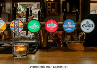 Dublin, OCT 28: Many different kind of tap beer inside the famous Temple Bar on OCT 28, 2018 at Dublin, Ireland