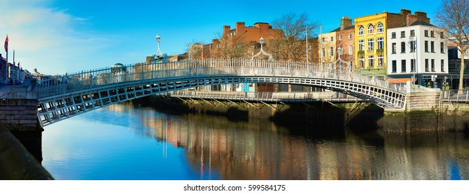 Dublin, panoramic image of Half penny bridge, or Ha'penny bridge, on a bright day