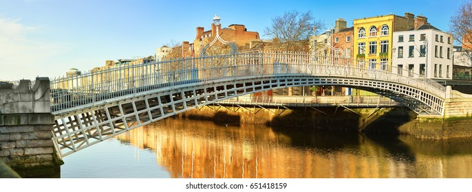 Dublin, panoramic image of Half penny bridge, or Ha'penny bridge, on a bright day