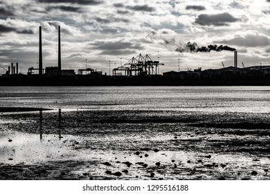 Dublin port Silhouette with clouds and river reflection, Ireland