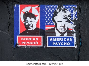 """Dublin, Rebublic of Ireland (Eire). Fall 2018.  Political poster on black wall depicting leaders of North Korea and United States of America under title """"Psycho"""".  Attempt made to remove."""