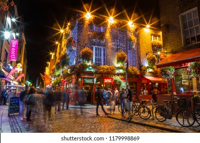 Dublin, Republic of Ireland - August 12th 2018: A night-time view of the historic Temple Bar area in the city of Dublin, Ireland.