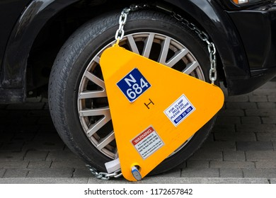 Dublin, Republic of Ireland - August 13th 2018: A close-up of a wheel clamp on a vehicle in the city of Dublin, on 13th August 2018.