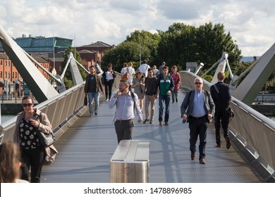 Dublin / Republic of Ireland - August 2019 : Streets of Dublin during rush hours. People returning from work walking on Seán O'Casey foot bridge