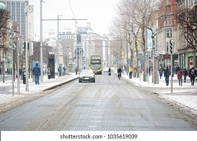 Dublin/Ireland - 02/28/2018. Beast from the East, Cars, Dublin bus and Luas on Oconnel Street in the centre of Dublin covered in snow.
