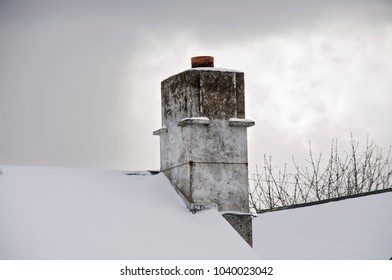 DUBLIN.IRELAND - February 28 , 2018: The chimney on the roof covered with snow as a result of a snow storm in Ireland.