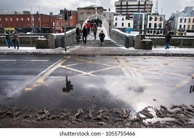 DUBLIN.IRELAND - February 28 , 2018: melting snow on a street road as a result of a snow storm in Ireland.
